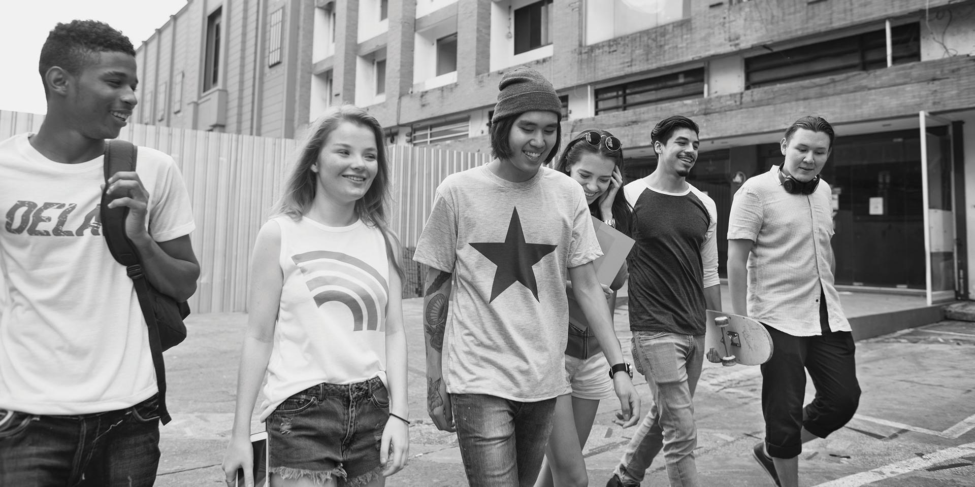 Group of young people walking together