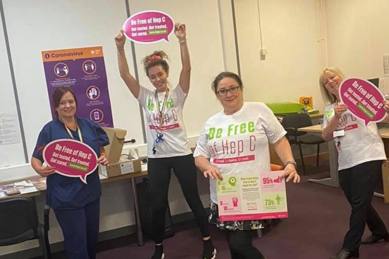 The St Helens Team holding Be Free Of Hep C signs