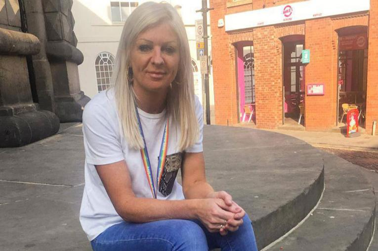 A woman sat on steps outside