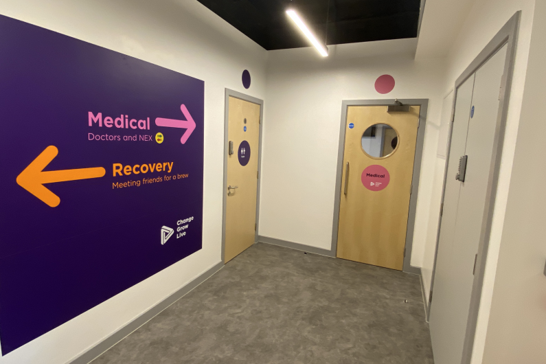 A hallway in the Wirral hub with signposts to different places in the service