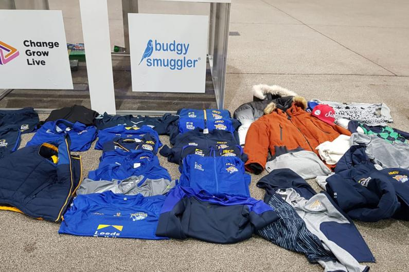 Photos of the rugby kit folded on the floor