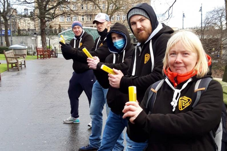 A team of people holding naloxone