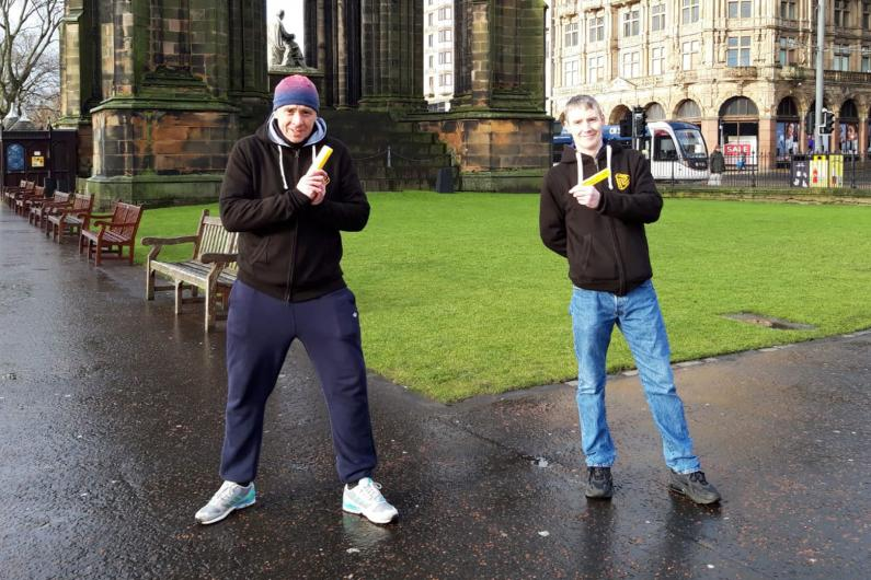 Two people in Edinburgh holding naloxone